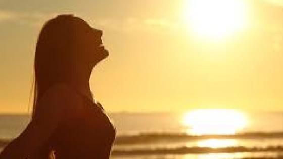 Woman, Sun and Beach